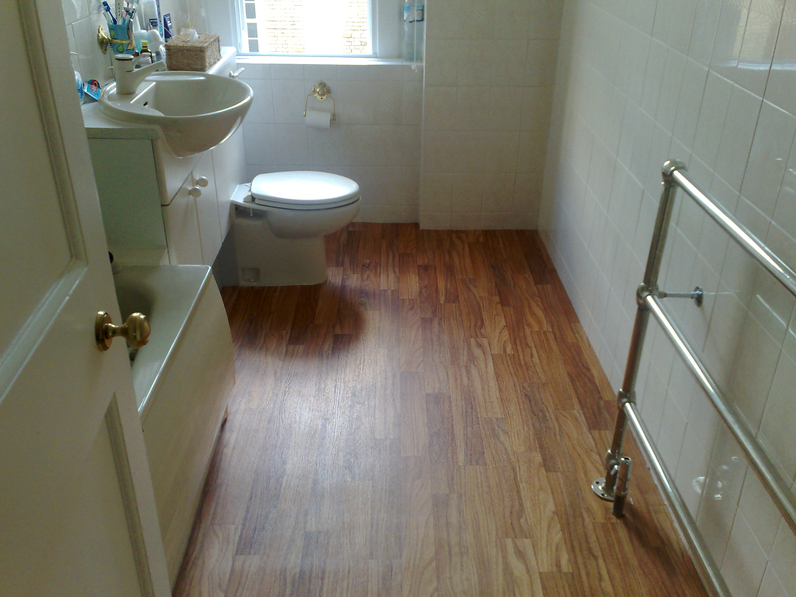 Wood flooring gallery bathroom for Hardwood floor in bathroom